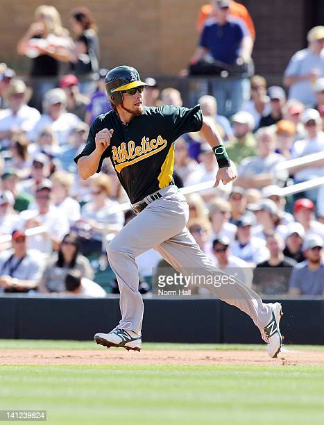 Josh Reddick of the Oakland Athletics runs to second base against the Colorado Rockies at Salt River Fields at Talking Stick on March 9 2012 in...