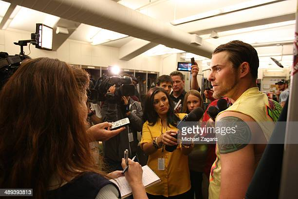 Josh Reddick of the Oakland Athletics talks with the media in the clubhouse following the game against the Houston Astros at Oco Coliseum on April 19...