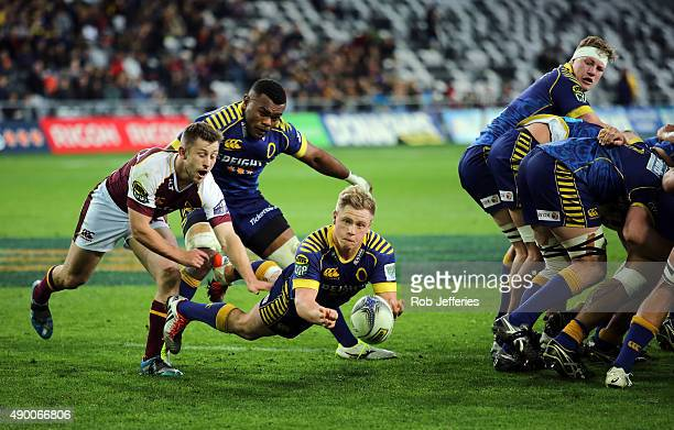 Josh Renton of Otago dives passes the ball during the round seven ITM Cup match between Otago and Southland at Forsyth Barr Stadium on September 26...