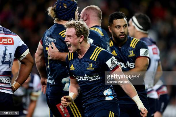 Josh Renton of the Highlanders celebrates Greg PleasantsTate of the Highlanders try during the round 19 Super Rugby match between the Highlanders and...