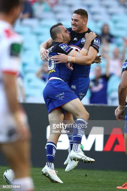 Josh Reynolds and Brenko Lee of the Bulldogs celebrate Reynolds scoring a try during the round 26 NRL match between the St George Illawarra Dragons...