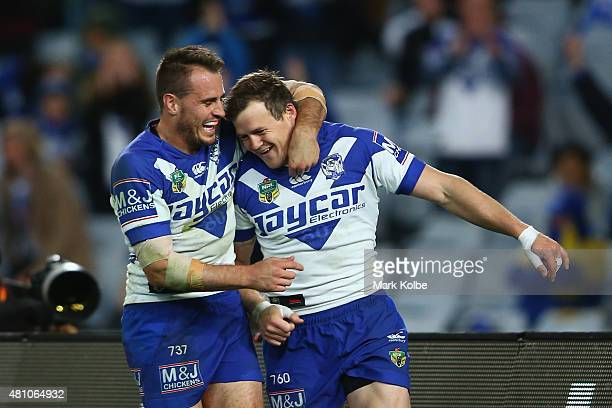 Josh Reynolds and Brett Morris of the Bulldogs celebrate after Morris scored a try during the round 19 NRL match between the Parramatta Eels and the...