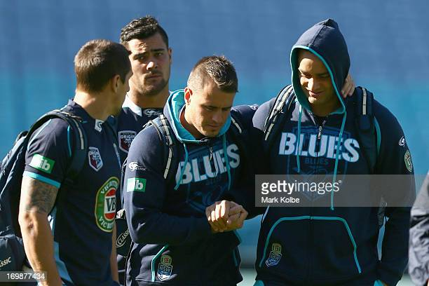 Josh Reynolds and John Sutton shake hands as they arrive for a New South Wales Blues state of origin training session at ANZ Stadium on June 4, 2013...