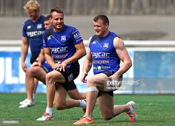 Josh Reynolds and Josh Morris stretch during a Canterbury Bulldogs NRL training session at Belmore Sports Ground on September 24 2014 in Sydney...