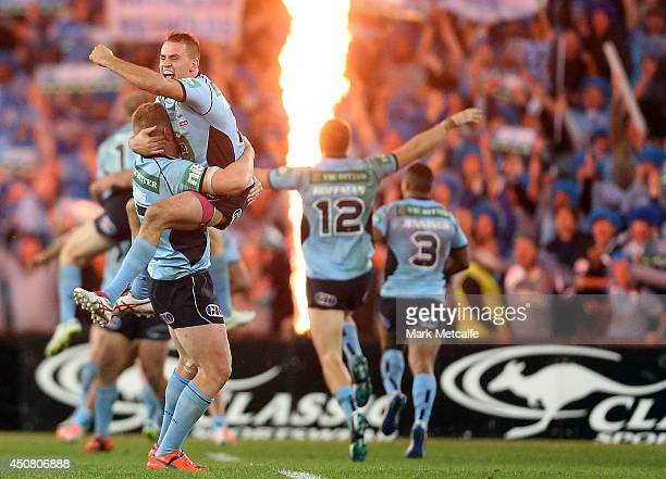 Josh Reynolds and Luke Lewis of the Blues celebrate victory in game two of the State of Origin series between the New South Wales Blues and the...