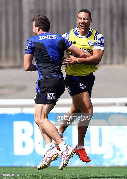 Josh Reynolds and Moses Mbye celebrate during a Canterbury Bulldogs NRL training session at Belmore Sports Ground on September 3 2014 in Sydney...