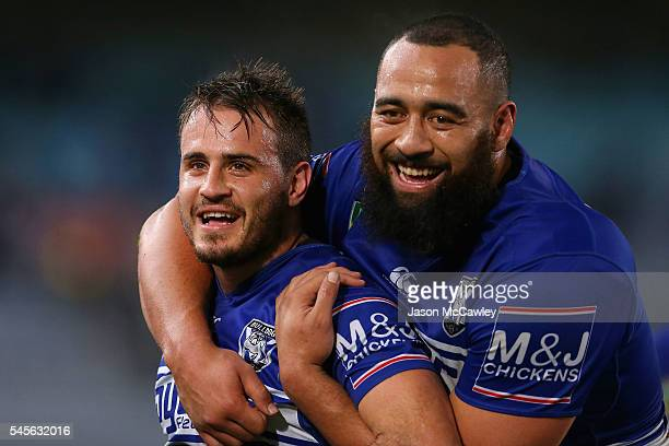 Josh Reynolds and Sam Kasiano of the Bulldogs celebrate victory at the end of the round 18 NRL match between the Canterbury Bulldogs and the Wests...