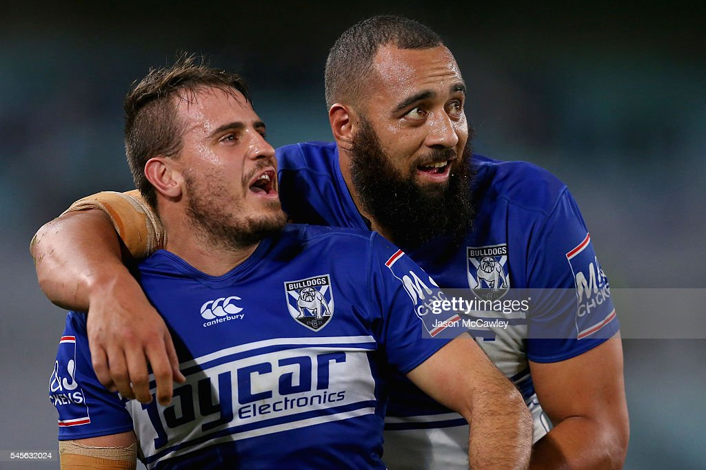 Josh Reynolds and Sam Kasiano of the Bulldogs celebrate victory at the end of the round 18 NRL match between the Canterbury Bulldogs and the Wests Tigers at ANZ Stadium on July 9, 2016 in Sydney, Australia.
