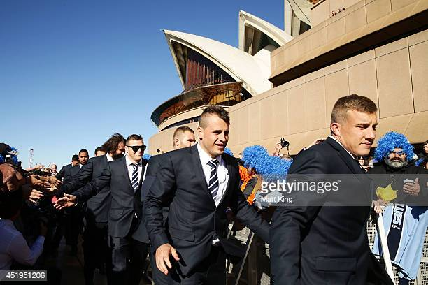 Josh Reynolds and Trent Hodkinson celebrate with fans during the NSW Blues State of Origin series victory celebrations at Sydney Opera House on July...