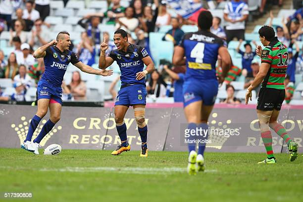 Josh Reynolds and Will Hopoate of the Bulldogs celebrate Will Hopoate scoring a try during the round four NRL match between the South Sydney...