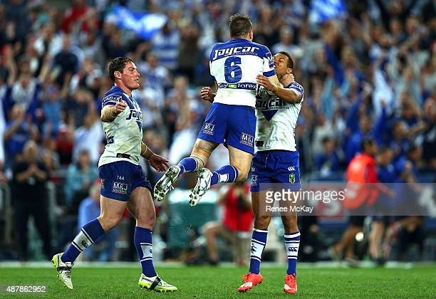 Josh Reynolds celebrates his winning field goal with Josh Jackson and Moses Mbye during the NRL Elimination Final match between the Canterbury...