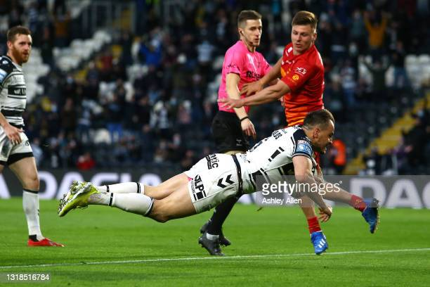 Josh Reynolds of Hull FC dives in to score a Try during the Betfred Super League round 6 match between Hull FC and Catalans Dragons at the KCOM...