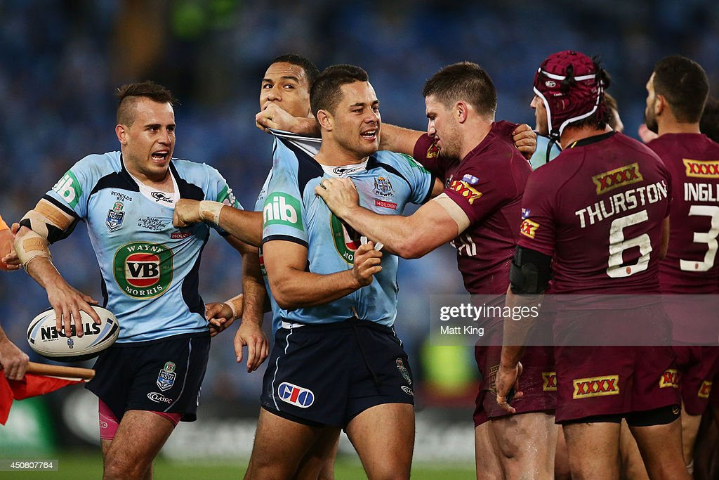 Josh Reynolds (L) of the Blues and Johnathan Thurston (R) of the Maroons clash during game two of the State of Origin series between the New South Wales Blues and the Queensland Maroons at ANZ Stadium on June 18, 2014 in Sydney, Australia.