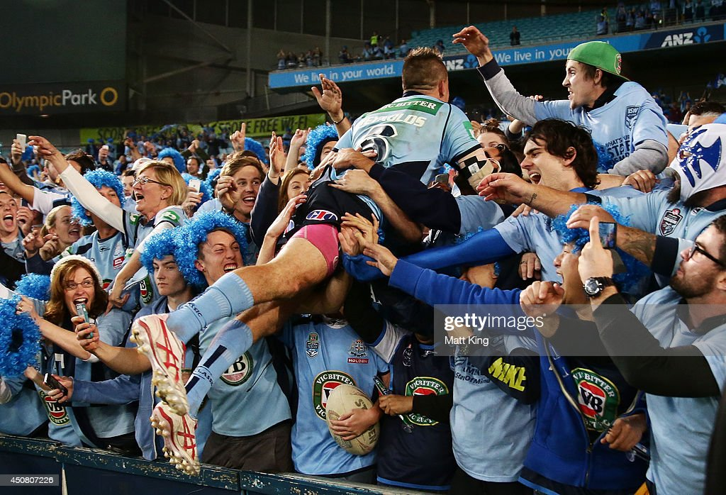 Josh Reynolds of the Blues celebrates the series victory with fans at the end of game two of the State of Origin series between the New South Wales Blues and the Queensland Maroons at ANZ Stadium on June 18, 2014 in Sydney, Australia.