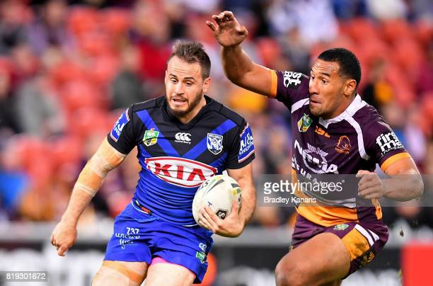 Josh Reynolds of the Bulldogs breaks away from the defence during the round 20 NRL match between the Brisbane Broncos and the Canterbury Bulldogs at...