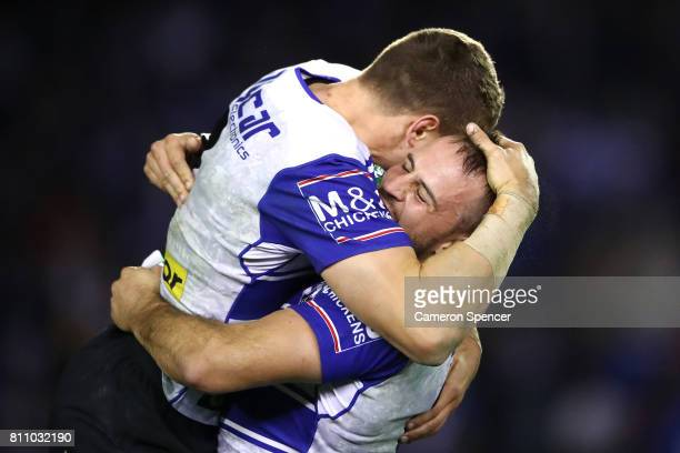 Josh Reynolds of the Bulldogs celebrates a conversion kicked by team mate Kerrod Holland during the round 18 NRL match between the Canterbury...
