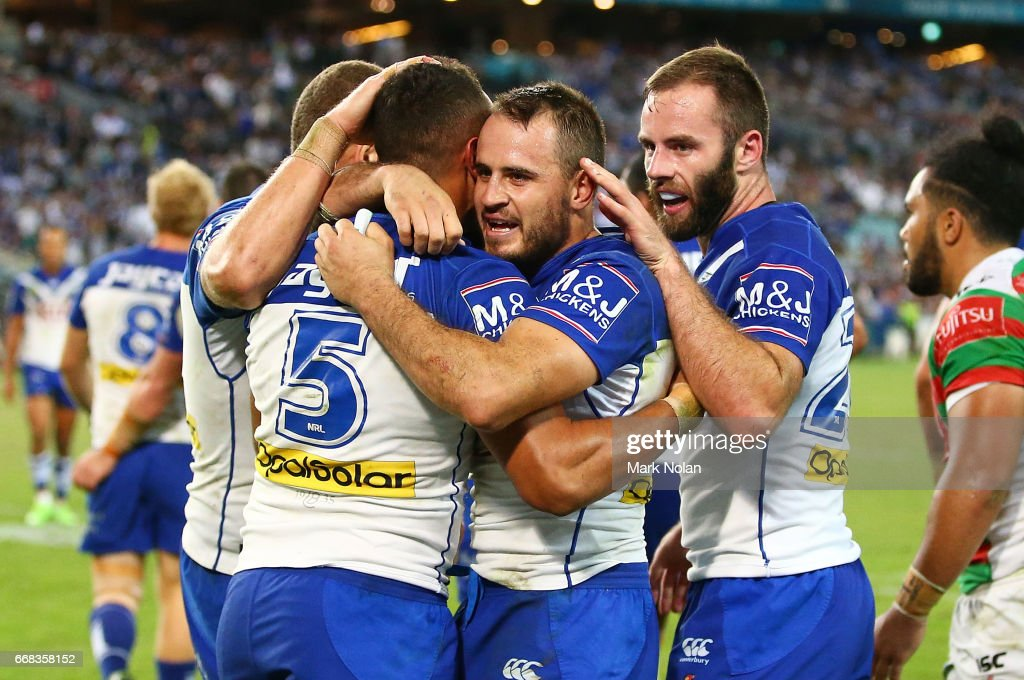 Josh Reynolds of the Bulldogs celebrates a try by Josh Morris during the round seven NRL match between the Canterbury Bulldogs and the South Sydney Rabbitohs at ANZ Stadium on April 14, 2017 in Sydney, Australia.