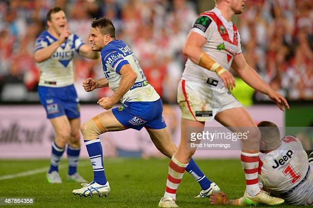 Josh Reynolds of the Bulldogs celebrates kicking a field goal to win the match during the NRL Elimination Final match between the Canterbury Bulldogs...