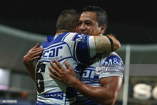 Josh Reynolds of the Bulldogs celebrates with Chase Stanley of the Bulldogs after he scored a try during the round five NRL match between the Sydney...