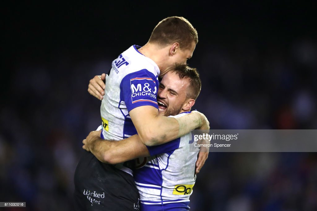 Josh Reynolds of the Bulldogs celebrates with team mate Kerrod Holland during the round 18 NRL match between the Canterbury Bulldogs and the Newcastle Knights at Belmore Sports Ground on July 9, 2017 in Sydney, Australia.