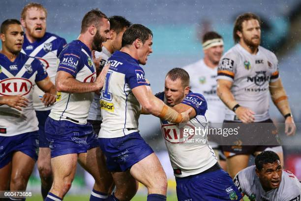 Josh Reynolds of the Bulldogs celebrates with team mates after scoring a try during the round five NRL match between the Canterbury Bulldogs and the...