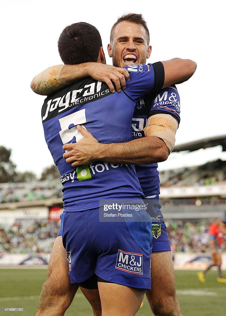 Josh Reynolds of the Bulldogs congratulates Corey Thompson of the Bulldogs during the round 11 NRL match between the Canberra Raiders and the Canterbury Bulldogs at GIO Stadium on May 24, 2015 in Canberra, Australia.