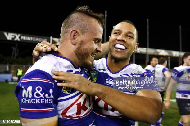 Josh Reynolds of the Bulldogs embraces team mate Moses Mbye of the Bulldogs after scoring the winning try during the round 18 NRL match between the...