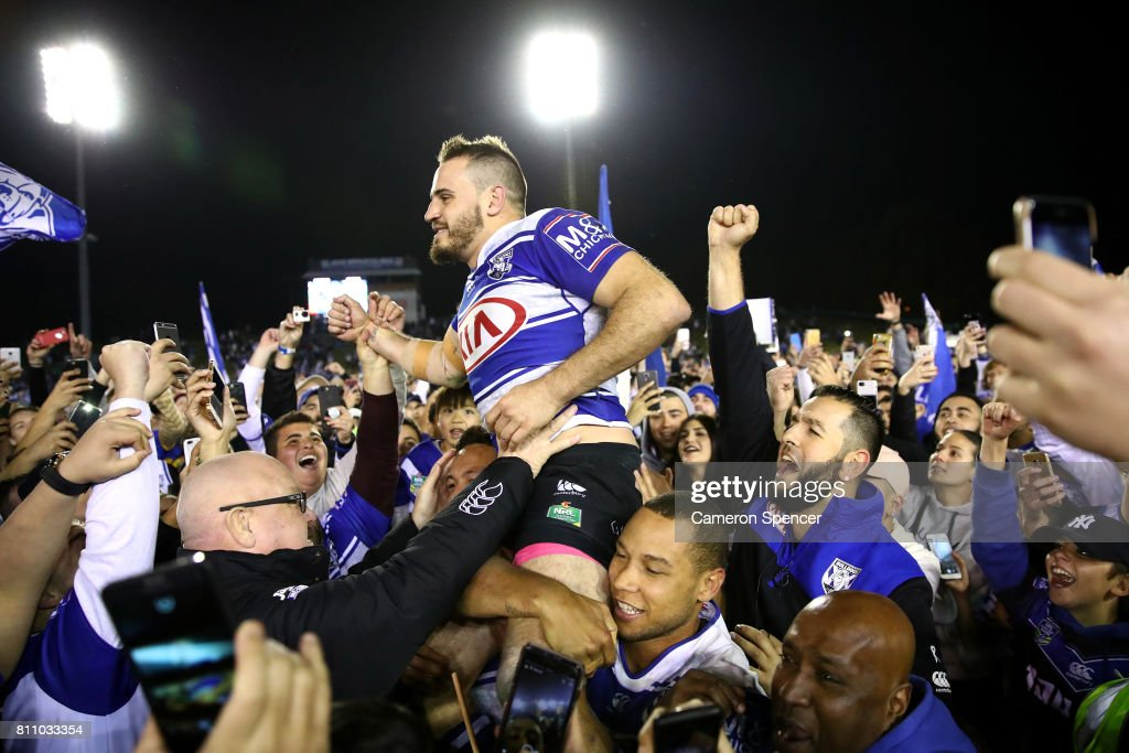 Josh Reynolds of the Bulldogs is chaird off the field after winning the round 18 NRL match between the Canterbury Bulldogs and the Newcastle Knights at Belmore Sports Ground on July 9, 2017 in Sydney, Australia.