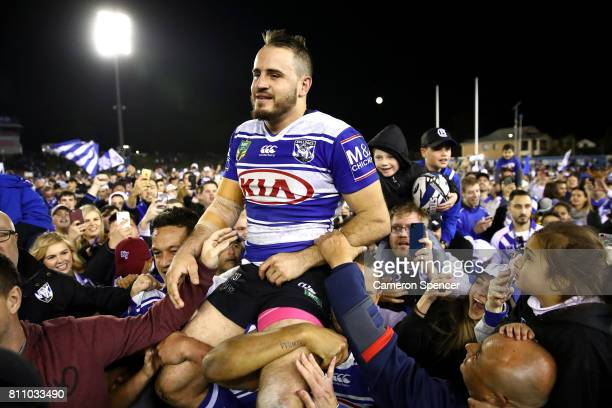 Josh Reynolds of the Bulldogs is chaird off the field after winning the round 18 NRL match between the Canterbury Bulldogs and the Newcastle Knights...