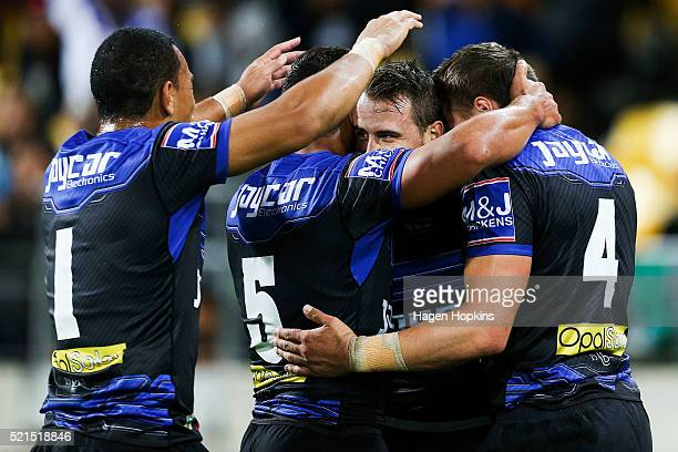 Josh Reynolds of the Bulldogs is congratulated on his try by teammates Will Hopoate Sam Perrett and Kerrod Holland during the round seven NRL match...
