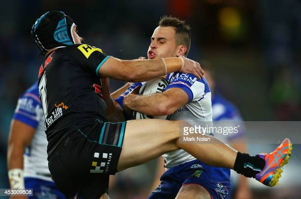 Josh Reynolds of the Bulldogs is tackeld by Jamie Soward of the Panthers during the round 21 NRL match between the Canterbury Bulldogs and the...