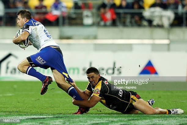 Josh Reynolds of the Bulldogs is tackled by Ben Henry of the Warriors during the round nine NRL match between the New Zealand Warriors and the...