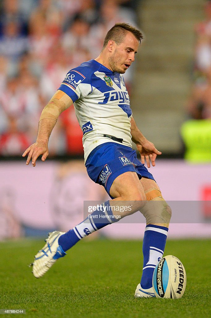 Josh Reynolds of the Bulldogs kicks a field goal to win the match during the NRL Elimination Final match between the Canterbury Bulldogs and the St George Illawarra Dragons at ANZ Stadium on September 12, 2015 in Sydney, Australia.