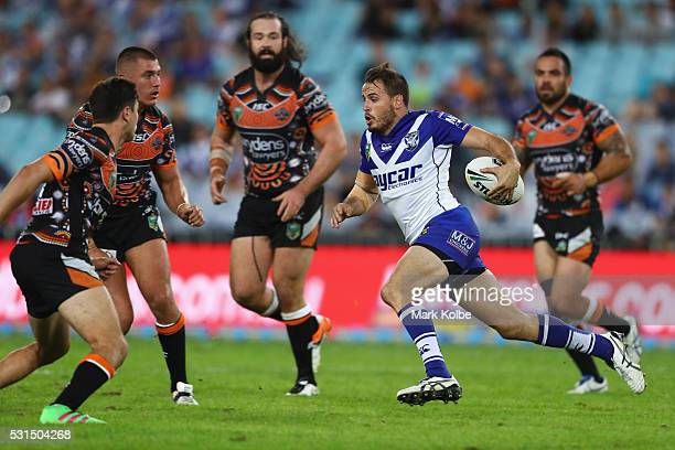 Josh Reynolds of the Bulldogs runs the ball during the round 10 NRL match between the Wests Tigers and the Canterbury Bulldogs at ANZ Stadium on May...