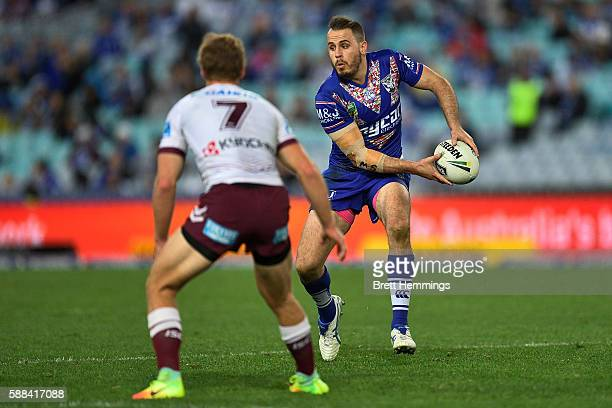 Josh Reynolds of the Bulldogs runs the ball during the round 23 NRL match between the Canterbury Bulldogs and the Manly Sea Eagles at ANZ Stadium on...