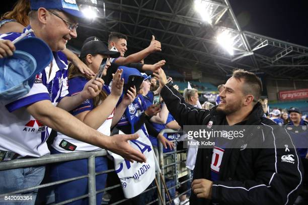 Josh Reynolds of the Bulldogs shakes hands with the crowd after victory during the round 26 NRL match between the St George Illawarra Dragons and the...