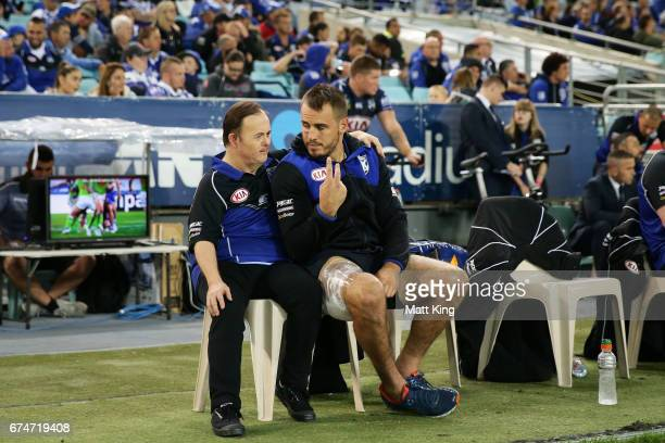 Josh Reynolds of the Bulldogs sits on the bench after leaving the field with an injury during the round nine NRL match between the Canterbury...