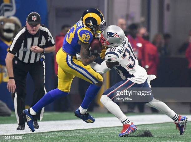 Josh Reynolds of the Los Angeles Rams tries to make a catch against Jason McCourty of the New England Patriots in the second half during Super Bowl...