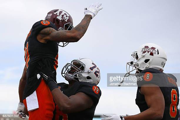 Josh Reynolds of the South team celebrates a touchdown with Jon Toth during the first half of the Reese's Senior Bowl against the North team at the...
