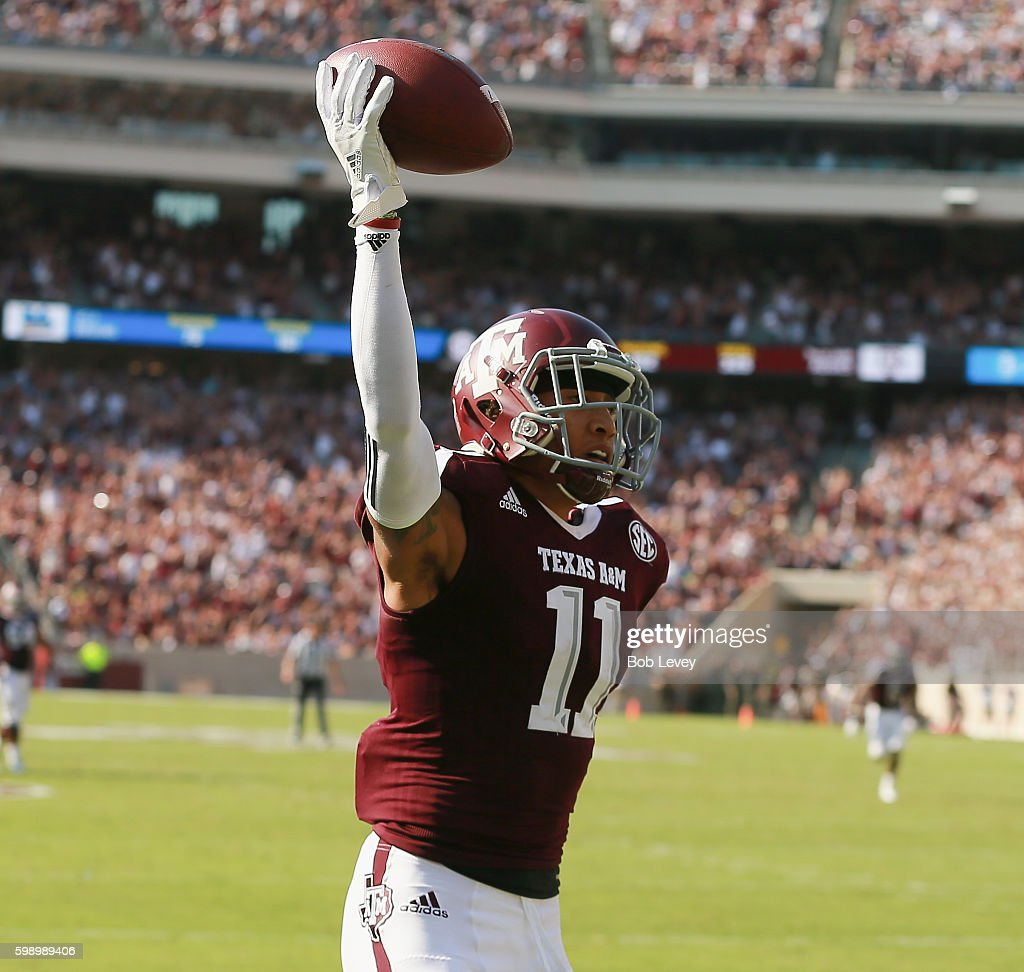 Josh Reynolds #11 of the Texas A&M Aggies catches a 40 yard touchdown pass in the third quarter against the UCLA Bruins at Kyle Field on September 3, 2016 in College Station, Texas.