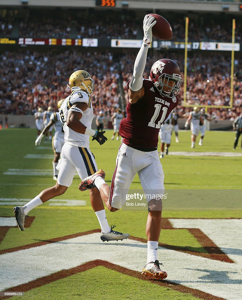 Josh Reynolds #11 of the Texas A&M Aggies catches a 40 yard touchdown pass in the third quarter as Marcus Rios #9 of the UCLA Bruins can't defend at Kyle Field on September 3, 2016 in College Station, Texas.