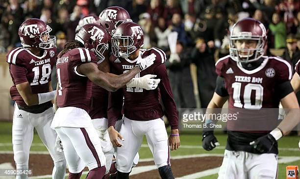 Josh Reynolds of the Texas AM Aggies celebrates his touchdown reception with teammates from Kyle Allen of the Texas AM Aggies against the Missouri...