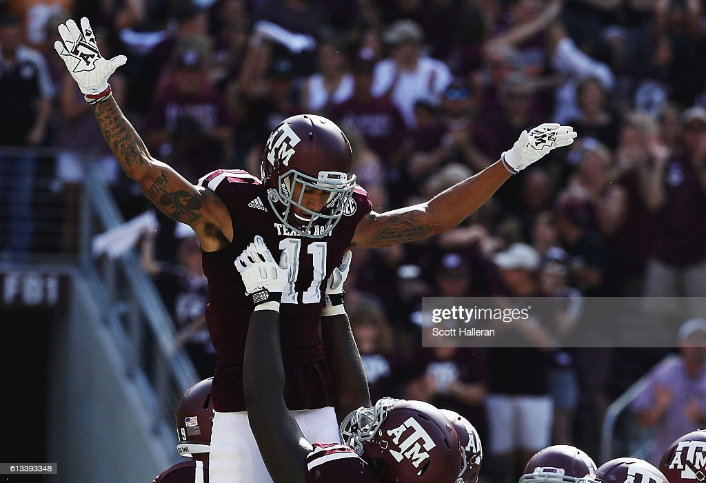 Josh Reynolds #11 of the Texas A&M Aggies celebrates with his teammates after a 2 yard touchdown in the first half of their game against the Tennessee Volunteers at Kyle Field on October 8, 2016 in College Station, Texas.