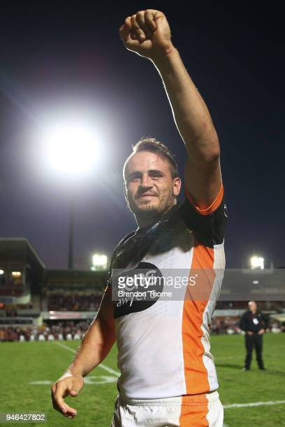 Josh Reynolds of the Tigers celebrates at full time during the round six NRL match between the Manly Sea Eagles and the Wests Tigers at Lottoland on...