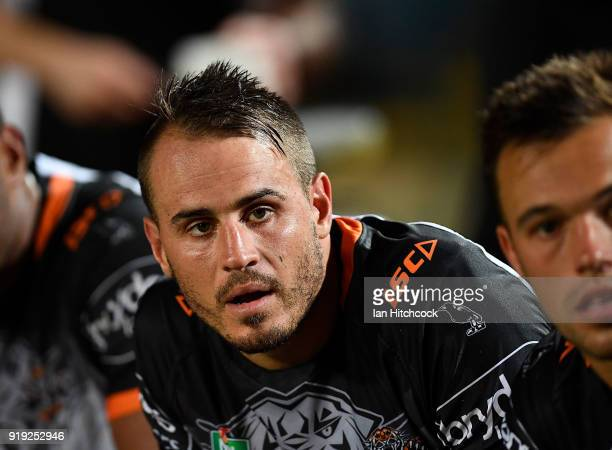 Josh Reynolds of the Tigers looks on from the bench during the NRL trial match between the North Queensland Cowboys and the Wests Tigers at Barlow...