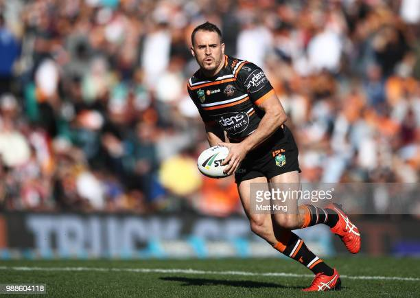 Josh Reynolds of the Tigers runs with the ball during the round 16 NRL match between the Wests Tigers and the Gold Coast Titans at Leichhardt Oval on...