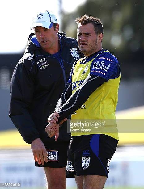 Josh Reynolds talks with assistant Kelly Egan during a Canterbury Bulldogs NRL training session at Belmore Sports Ground on August 12, 2014 in...