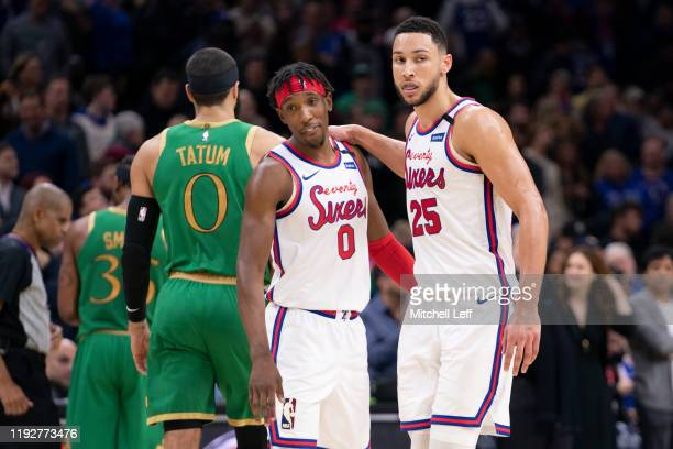 Josh Richardson and Ben Simmons of the Philadelphia 76ers embrace in front of Jayson Tatum of the Boston Celtics in the fourth quarter at the Wells...