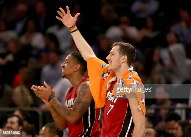 Josh Richardson and Goran Dragic of the Miami Heat celebrate in the fourth quarter against the New York Knicks at Madison Square Garden on March 29...