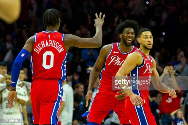 Josh Richardson Ben Simmons and Joel Embiid of the Philadelphia 76ers react after Simmons made a three point basket in the second quarter against the...